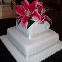 Lillywedd.jpg   Square cakes, covered in fondant, flowers are artificial.