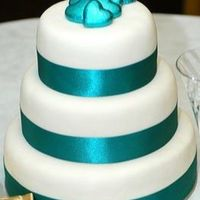 Jade.jpg  This was just a plain, simple wedding cake for a lady who wasn't really into the girly, frilly part of getting married. The chocolates...