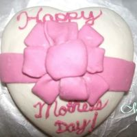 Mother's Day Cake A friend ordered a cake for her mom for Mother's day. It turned out cute. Its yellow cake with vanilla frosting, using MM fondant on a...
