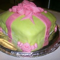 Pink & Green Ribbon Gift Cake This was my first time using fondant, I was facinated of what you can do with fondant, so I made MM fondant on a vanilla cake just using...