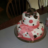 Pink & Brown Polka Dot Baby Shower Cake I made this for my sister in law's baby shower. It is my 4th fondant covered cake. Shoes were made using a pattern from this site.