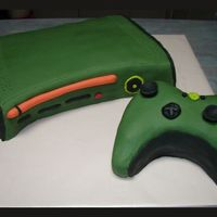 X-Box 360 Halo Edition This is the Halo edition of an x-box 360, just in case you wondered about the green. Just a chocolate mud cake with Fondant icing.