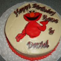L_E170Bf2D5B2D4929B444Bb15D4Eb.jpg   almond butter cake with imbc . elmo and wording are E.I.