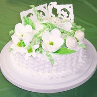 English Garden I made ths cake for a Mother's day Luncheon at my church. Its a 9 inch butter cake with buttercream frosting. The flowers are made of...