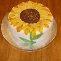 Sunflower Leaves made of fondant, seeds are piped chocolate icing. TFL!