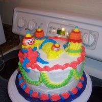 My 'safety Clown' Cake 1st cake, 1st time coloring frosting, my colors came out florescent! So now i call these my 'safety clowns!'