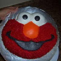 It's Elmo! My first character cake, i didn't do the star tips, but make him look 'hairy' by using the grass tip. So fun to make! Next...