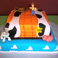 Toy Story Cakes covered in colored fondant. Hat, pig and edge-a-sketch also done in fondant