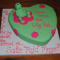 Lily Pad News This is a single layer cake, it is covered in fondant with a frog molded from fondant. I tried to make her look pregnant holding her belly...