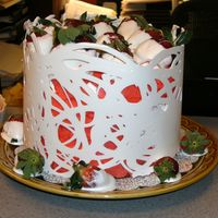 034.jpg Choc. wrapped cake with choc. covered strawberries