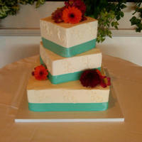 "September Scroll   6,8,and 12"" square, offset tiers. satin ribbon, simple scrolll and real flowers placed upon cake. TFL!"