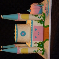 Castle Cake BC with fondant accents. Turrets and carriage made out of rice krisipie treats covered in fondant. TFL.