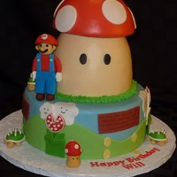 Super Mario Cake Borrowed idea from the many beautiful cakes on CC. Thanks for the inspiration. Iced in fondant, figures are fondant/tylose. TFL.