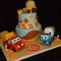 Construction Themed Birthday Cake All fondant. Trucks are made from rice krispie treats. Borrowed idea of trucks from someone on CC, thanks for the inspiration. TFL.