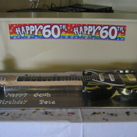 Electric Guitar Cake The main body of the guitar was made of vanilla sponge cake with vanilla b/c and raspberry jam filling and the neck was made from RCT, all...
