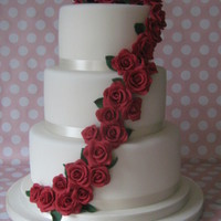 "Red Rose Wedding Cake 10"",8"" and 6"" vanilla sponge cake with vanilla b/c and raspberry jam filling, all covered in fondant with gumpaste roses...."