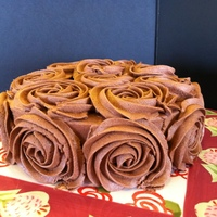 Chocolate Rosette Vertical Cake Made this cake off of a tutorial on i am baker dot comway easy to make and super yummyChocolate and strawberry cake with chocolate rosettes...