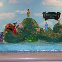Peter Pan Neverland Cake  This cake is my version of Neverland. I made it for my son's 1st birthday party. It is spice cake with cream cheese buttercream...