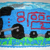 Train Birthday Cake Made this for one of my Grandsons Birthday . He turned 2 years old and he loves anything to do with trains . All buttercream icing .