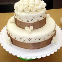 Tier.jpg fondant class final cake, MMF, roses are regular fondant, cake was devils food cake and french vanilla cake filled with chocolate and...