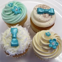 Turquoise Wedding Cupcakes Flavors include:TiramisuPistachioFluffer NutterCoconut Cream PieBows & flowers are gumpaste