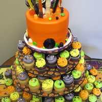 "Halloween Cupcake Tower & Cake This was our donation to a fundraiser for the Albuquerque Rescue Mission.6"" cake and 12 dozen mini cupcakes"