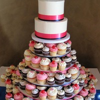 "Hot Pink & Navy Blue Cupcake Tower 8 dozen regular sized cupcakes & 8 dozen mini cupcakes6"" red velvet & 8"" carrot stacked cutting cakes with IMBC"