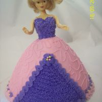 Barbie Doll Customer asked for a pink and purple cake with a doll. She loved it! All buttercream.
