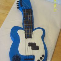 Guitar all buttercream with floral wire for strings. Customer is in a band and it has his logo on it. He loved it!