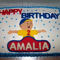 Caillou Cake 11x15 inch buttercream cake with fondant cutouts of Caillou