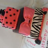Hot Pink & Zebra Stripes Made for 14 year old twin girls. All fondant