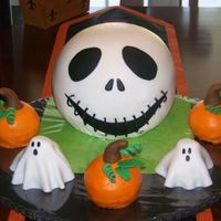 Jack Skellington Jack is a chocolate cake filled with chocolate SMBC covered in fondant. The pumpkins are WASC with choc. SMBC covered in cream cheese BC...