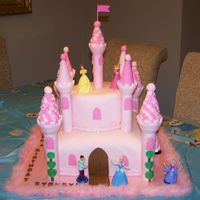 "Sydney's Castle Cake A castle cake for my daughter's 4th birthday. A 12"" square pink WASC filled with bubblegum mousse, covered in white chocolate BC..."