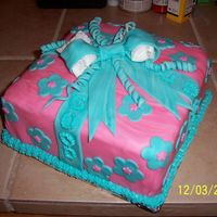 Good Luck 3 layer present cake. Cream cheese and strawberry filling. Has buttercream icing under the fondant. Fondant bow and accent pieces.