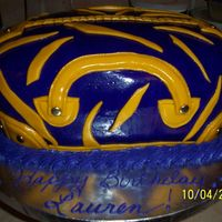 Lsu Purse This was done for a friend for her daughters birthday. White cake with coconut filling with buttercream icing. Then covered with MMF....