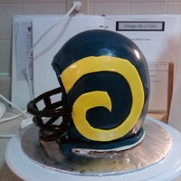 Ram's Football Helmet Birthday cake for my brother in law. Carrot Cake with cream cheese icing and fondant. Not too bad for my first helmet cake but learned a...