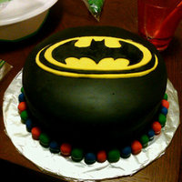 Batman Birthday Cake Cake I made for my little brother's birthday. A bit of a challenge because I had to fill and crumb coat with canned icing as that is...