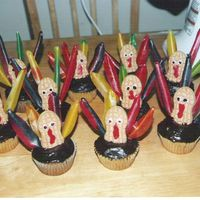 1St Thanksgiving Cup-Cakes vanilla cupcakes - chocolate frosting - (and fruit-rollups candy, peanut bt. cookies.)