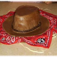 Cowboy Hat Cake  First and maybe last time I'll ever make a hat cake. Made this cake to replicate the hat my dad owns. Didn't turn out like I...