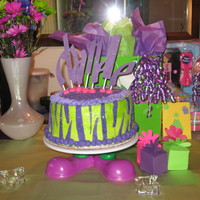 Chanele's 11Th B-Day Cake   Chocolte cake with BC. MMF accents! Alot of sugar glitter! Letters cut with Cricut!
