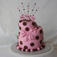 "Pink & Brown Topsy Turvy   4"" 6"" Rounds carved and iced in fondant with fondant bow and dots."