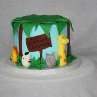 "Animals In The Brush   6"" Round iced in fondant with animals hand made from fondant. Fondant leaves on top."