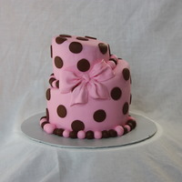 "Topsy Turvy Pink & Brown Dots 4"" 6"" Rounds iced in fondant with fondant dots, bow and ball border."