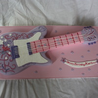 "Hannah Montana Guitar Cake   9x13 & 8"" square cake carved into guitar shape, torted, filled and covered in fondant."