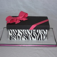 Zebra Gift Box  9x13 Sheet cut in half and stacked. Iced in fondant with fondant lid and bow. Zebra stripes out of fondant. Lid opened up to reveal a...