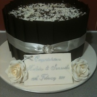 Cheesecake Wedding Cake Double decker new york baked cheesecake with dark chocolate panels, white and dark chocolate shavings and gumpaste roses.