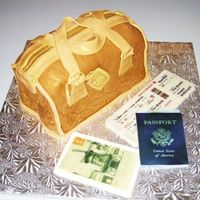 Travel Bag I made this cake for one of my best friends who's always traveling! It was a Tiramisu cake with coffe fondant. The Passport, Post card...