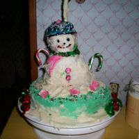 Snowman Coconut cake made with butter Cream Frosting. The grandchildren ha a lot of fun with this one.