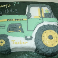 John Deere Tractor Cake I made this for our neighbor boy who, of course, loves anything John Deere.
