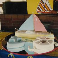 Sail On.. All cakes were covered in fondant, cut and shaped into a nautical theme. Sailboat sails were made out of gumpaste.
